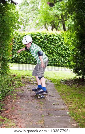 Young Boy On His Skate Board