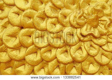 Textured abstract gold patterned rough skin for the background.