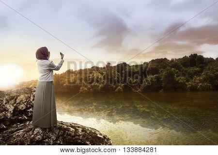 Muslim Woman Praying At The Lake