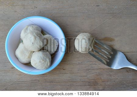 pork ball stab in the fork on table