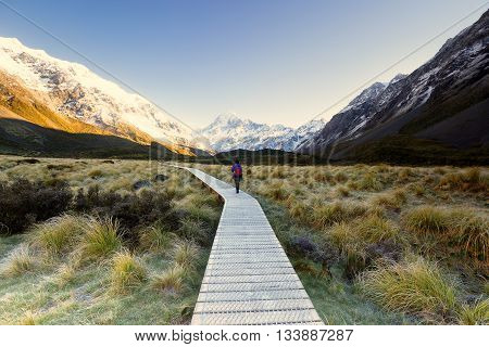 A hiker mesmerized by beautiful landscape at Hooker Valley track.