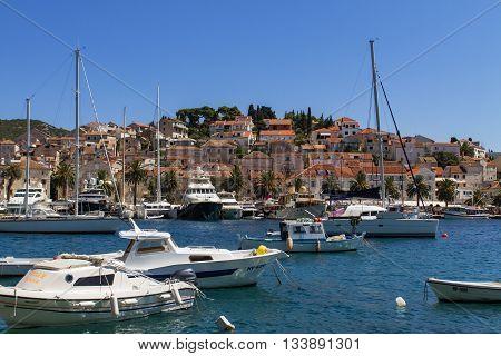 HVAR, CROATIA - SEPTEMBER 8, 2014: Boats at marina in Hvar Croatia. Hvar is one of the most popular and most visited destination in Croatia.