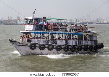 MUMBAI, INDIA - OCTOBER 11, 2015: Unidentified people on a ferry. Water transport in Mumbai consists mostly of ferries. Services are provided by both government agencies as well as private partners.