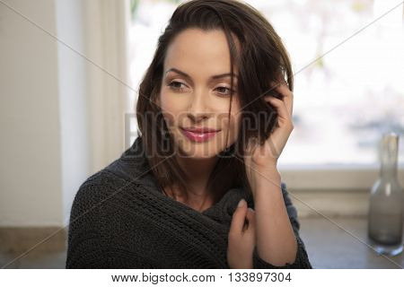 Brunette atrractive young woman wearing a cardigan