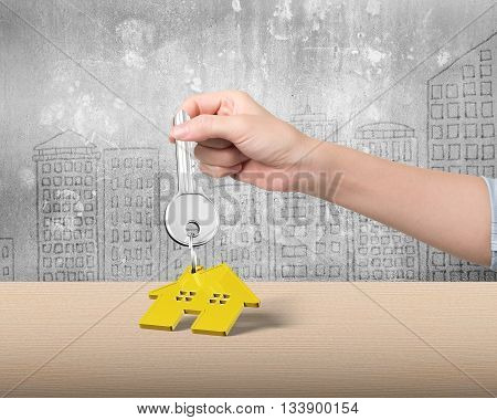 Woman Hand Holding Key With House Shape Keyring, 3D Illustration