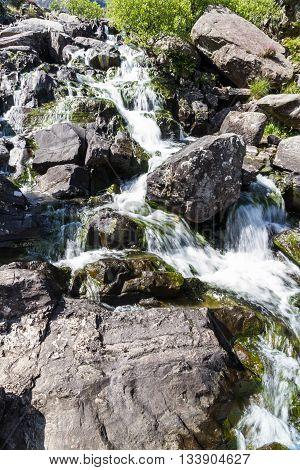 Stream tumbling down from Lake Idwal Ogwen Cottage the Nant Ffrancon Valley Gwynedd Wales United Kingdom