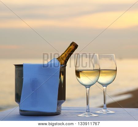 Romantic dinner at sunset on the beach