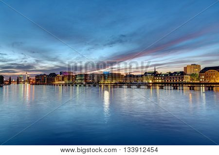 The river Spree in Berlin at dawn with the famous television tower in the back