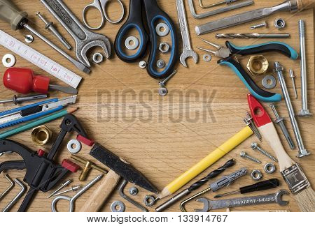 Happy fathers day: tools symbol heart on wooden background. Construction concept
