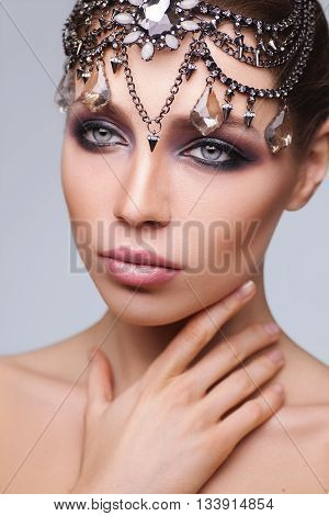 Fashion brunette woman with beautiful face . Skin care concept