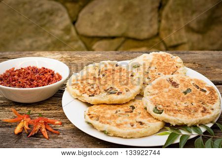 Sri Lankan pol roti or coconut rotti with hot lunu miris