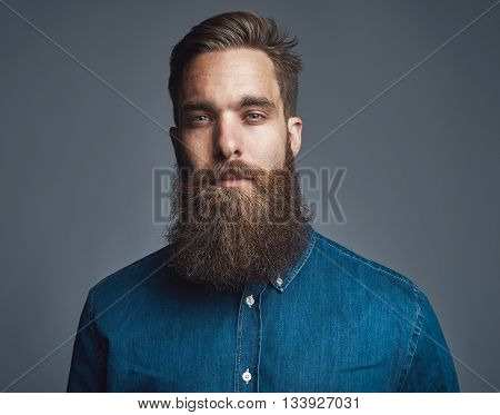 Bearded Man In Blue Denim With Tired Expression