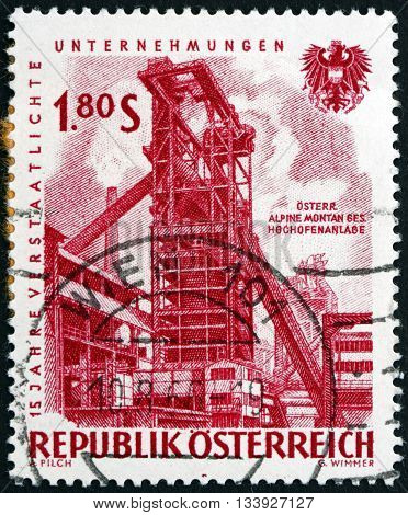 AUSTRIA - CIRCA 1961: a stamp printed in Austria shows Iron Blast Furnace 15th Anniversary of Nationalized Industry circa 1918