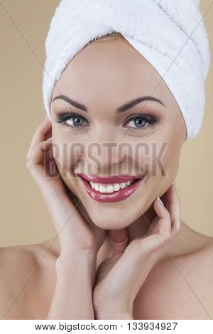 Smiling is my beauty secret. Close up of beautiful young blonde with flawless skin isolated on brown background in studio