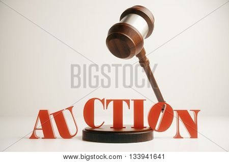 Wooden auction gavel in mid air on light background. 3D Rendering