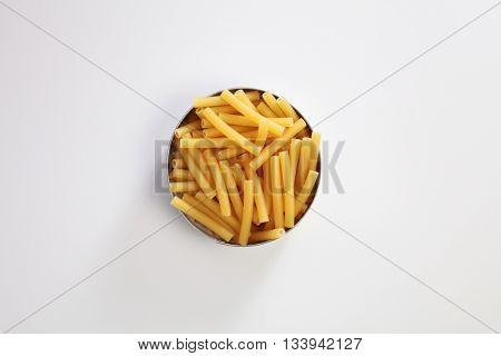Maccheroni dry pasta on the white background