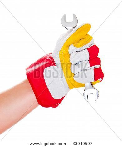 gloved hand with wrench on white background