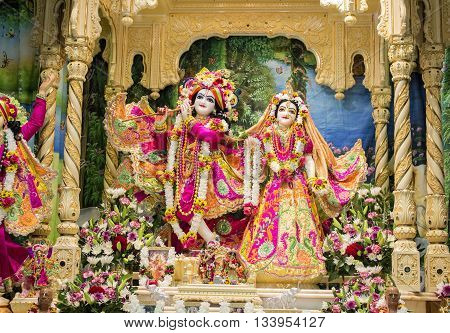 Durban, South Africa -  March 20, 2016: Hindu god Krishna with his wife Radha. Bright colorful sculptural composition.