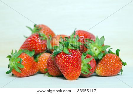 Strawberry Red ripe buddy of strawberry fruit on wooden board (Other names are Fragaria strawberry Fragaria ananassa)