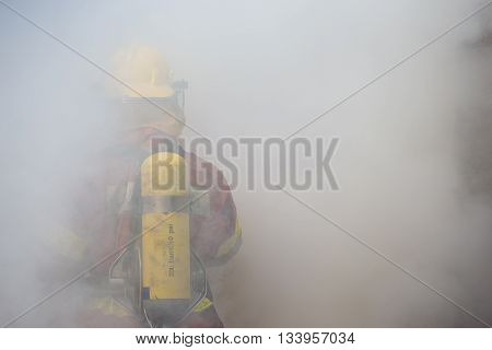 single fireman in operation surround with smoke