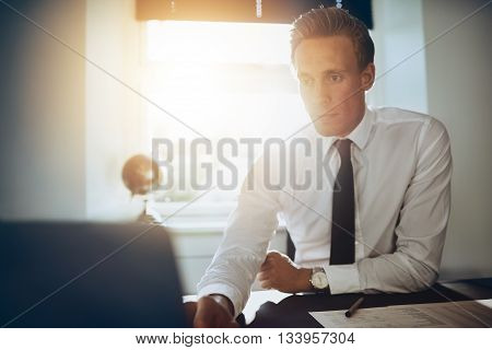 White Male Executive Business Man Working At His Laptop