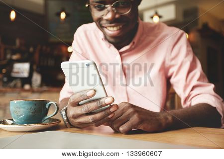 Film Effect. Portrait Of Cheerful African American Student Typing A Message On Smart Phone, Sharing