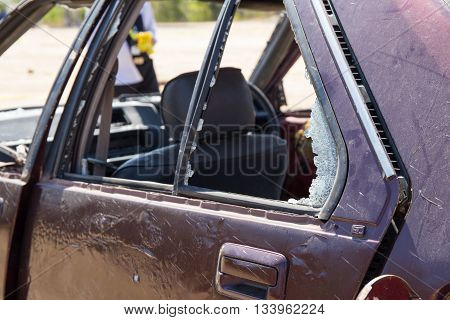 broken car window from car bomb in crime scene investigation