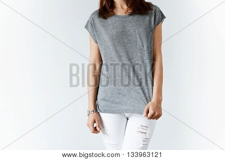 Fashionable Young Caucasian Woman Posing Indoor Against White Wall Background. Cropped Shot Of Hipst