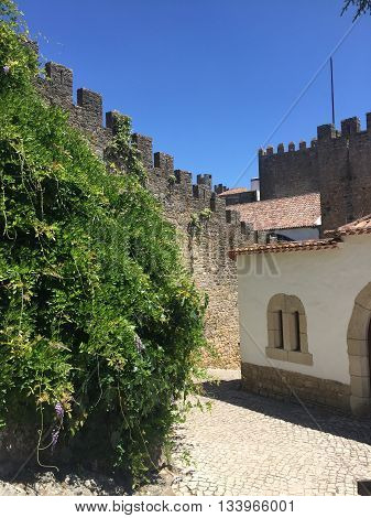 Medieval wall and tower in the town of Obidos, Portugal