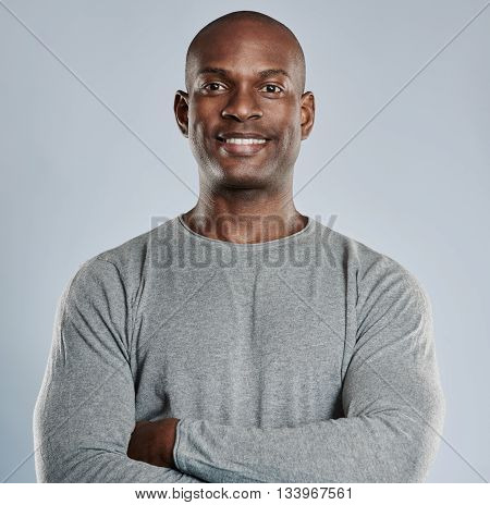 Confident Black Man With Pleasant Smile In Gray