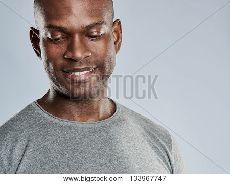 Attractive Grinning Man Looking Downward