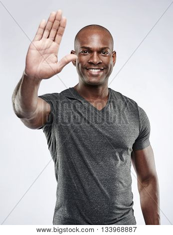 Cute Smiling Man Holding Palm Up