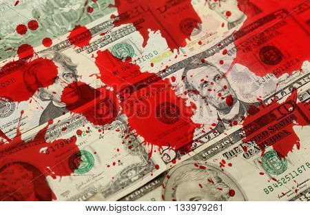 Money banknotes with bloodstains