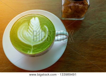 close up Hot green tea matcha latte in a cup;Latte art with Japanese green tea matcha