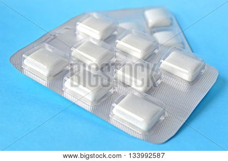 White chewing gum on a blue background