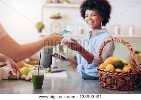 Juice Bar Owner Taking Payment From Customer