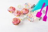 Pink homemade cupcakes and cookware. Birthday cupcakes. Homemade cupcake. Sweet dessert. Sweet pastry. Gourmet cupcakes. Sweet cupcake. poster