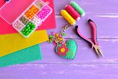 Bright handmade heart keychain with flower, beads. Felt, thread, pliers, needle, box, beads, pendants. Felt keychain suppliers. Set to create beautiful crafts. Love heart key ring. Felt heart ornament poster