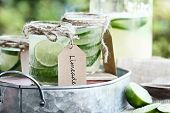 Limeade in mason jars with extreme shallow depth of field. poster