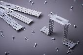 Fasteners for plasterboard, plasterboard fastening, set of building fasteners, building materials, steel fasteners for repair, construction works, modern building materials, screws for construction poster