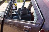 broken car window from car bomb in crime scene investigation poster