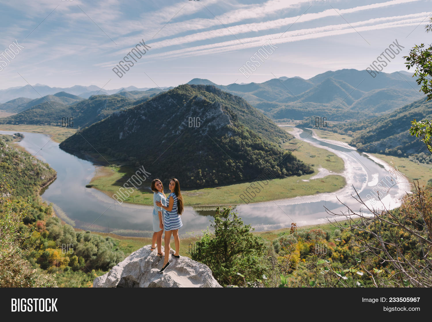 Two Girls Travelling In Mountains At Sunset With Beautiful View.  Picturesque Landscape Background. M 3ec5b1cbc1cf7