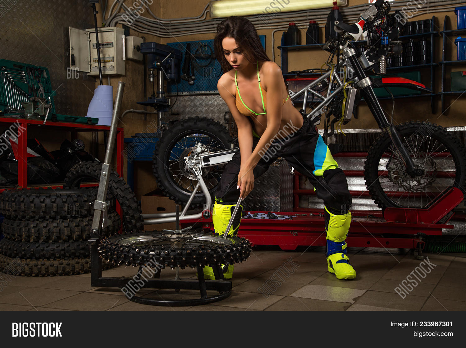 Sexy girl garage bike image & photo free trial bigstock