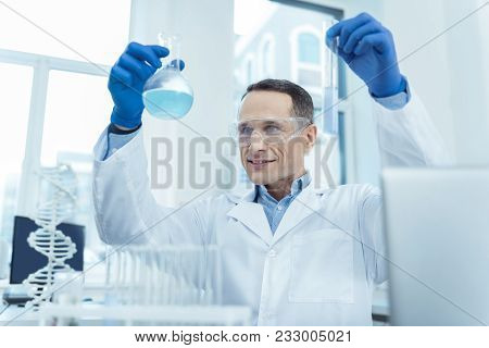 Enjoy It. Joyful Experienced Researcher Making A Dna Research In A Lab