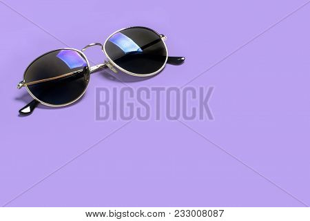 Stylish Fashionable Sun Glasses Isolated On A Purple Background. The Concept Of Stylish Poster, Bann