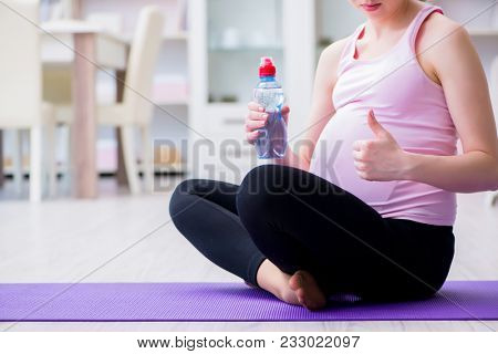 Pregnant woman exercising in anticipation of child birth