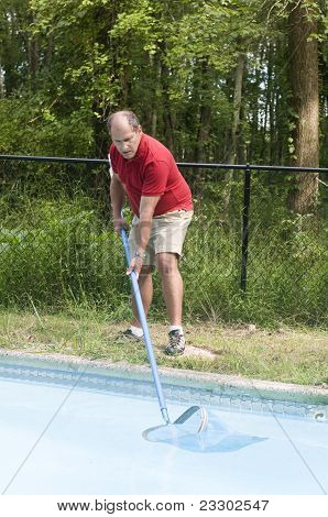 Homeowner Cleaning Swimming Pool
