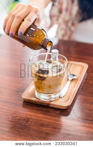 Coffee Cube Latte served with coffe ice cube and milk.