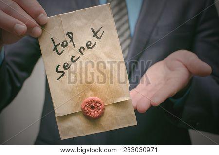 Top Secret Concept. Business Man Showing A Top Secret Documents Or Message In His Hands. Confidentia