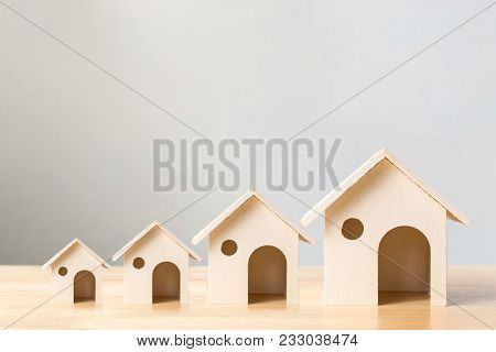 Property Investment And House Mortgage Financial Concept,wooden Houses Arranged Different Size In Ro